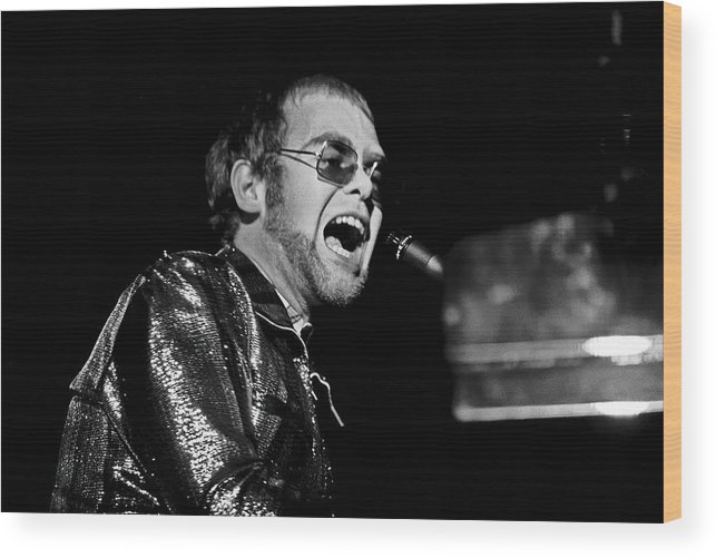 Elton Wood Print featuring the photograph ELTON JOHN AT PIANO c. 1975 by Daniel Hagerman
