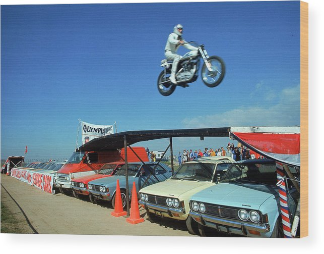 Timeincown Wood Print featuring the photograph Evel Knievel In Flight by Ralph Crane