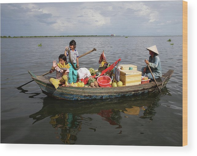 Child Wood Print featuring the photograph Family & Snake Sell Wares On Tonle by Rosemary Calvert