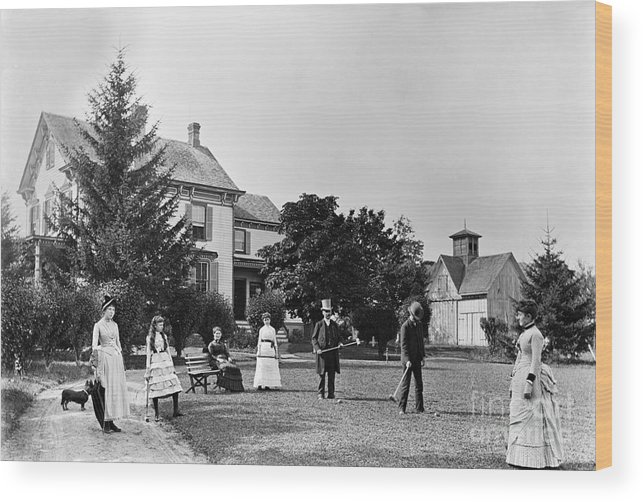 People Wood Print featuring the photograph Family Plays Croquet In Front Of Home by Bettmann