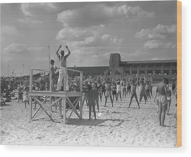 Human Arm Wood Print featuring the photograph Group Of People Exercising On Beach, B&w by George Marks