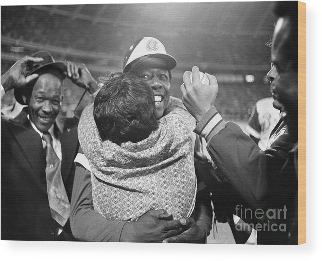 Atlanta Wood Print featuring the photograph Hank Aaron Hugging His Mother by Bettmann
