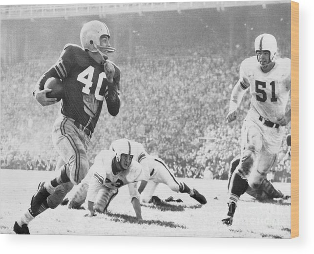 American Football Uniform Wood Print featuring the photograph Howard Cassady Running With Football by Bettmann