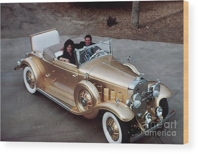 Mid Adult Women Wood Print featuring the photograph Jack Smith In Gold Plated 1931 Cadillac by Bettmann