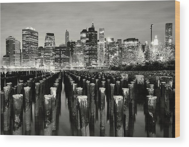 Wooden Post Wood Print featuring the photograph Manhattan At Night by Shobeir Ansari