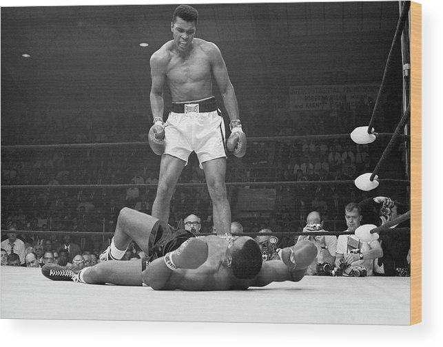 Heavyweight Wood Print featuring the photograph Muhammad Ali Taunting Sonny Liston by Bettmann