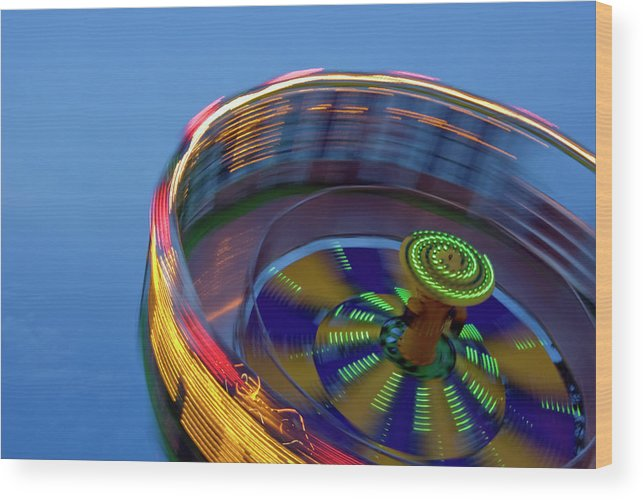 Carousel Wood Print featuring the photograph Multicolored Spinning Carnival Ride by By Ken Ilio