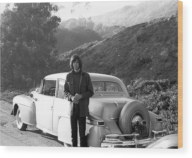 Singer Wood Print featuring the photograph Neil Young And His Classic Car by Michael Ochs Archives
