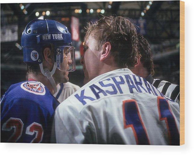 National Hockey League Wood Print featuring the photograph New York Rangers V New York Islanders by B Bennett