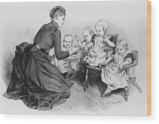 Toddler Wood Print featuring the photograph Nspcc Care by Hulton Archive