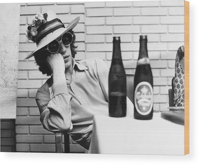 Mick Jagger Wood Print featuring the photograph Portrait Of Mick Jagger With A Sun Hat by Keystone-france