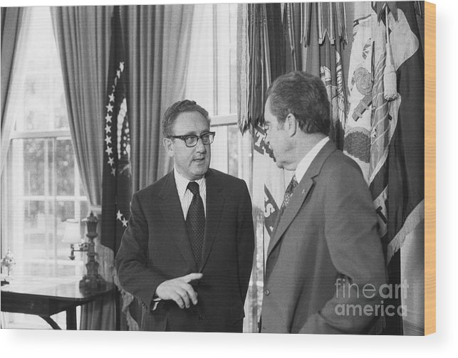 Mature Adult Wood Print featuring the photograph President Nixon And Henry A. Kissinger by Bettmann