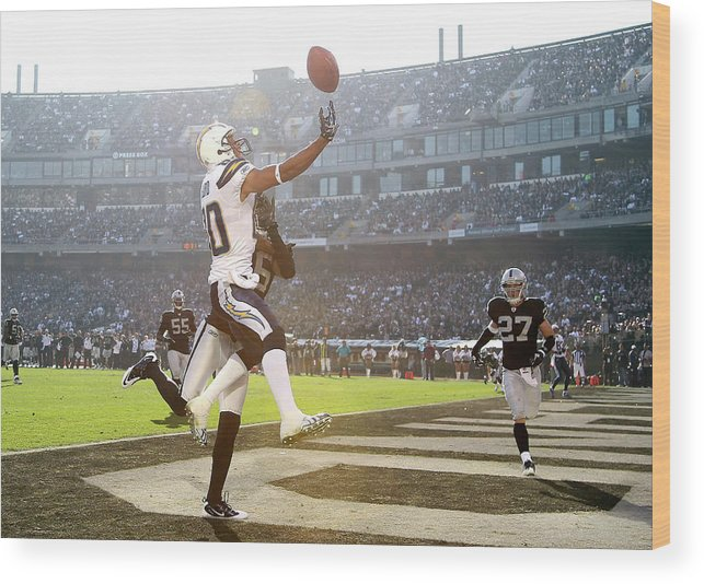 Oakland Wood Print featuring the photograph San Diego Chargers V Oakland Raiders by Ezra Shaw