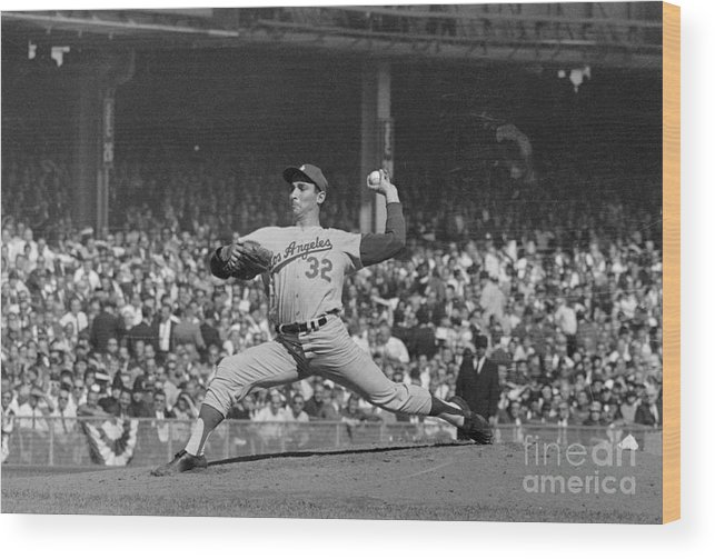 Sandy Koufax Wood Print featuring the photograph Sandy Koufax Pitching In World Series by Bettmann