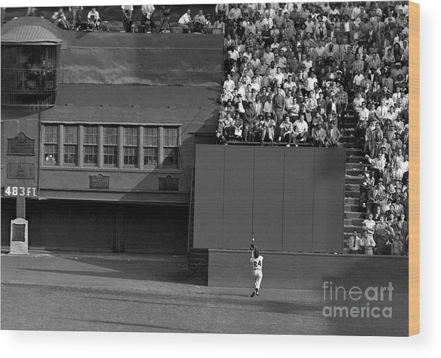 1950-1959 Wood Print featuring the photograph Willie Mays Makes His Famous Catch Off by New York Daily News Archive