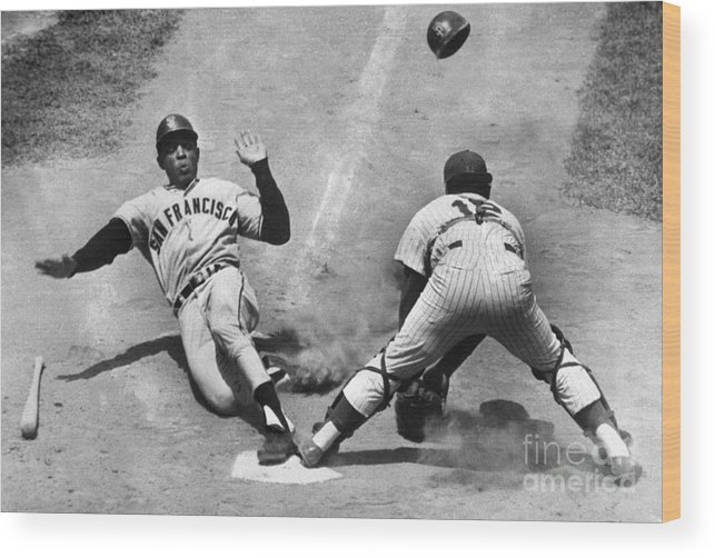 Headwear Wood Print featuring the photograph Willie Mays Sliding Into Home Plate by Bettmann