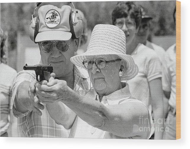 1980-1989 Wood Print featuring the photograph Woman Practicing Firing A Gun by Bettmann