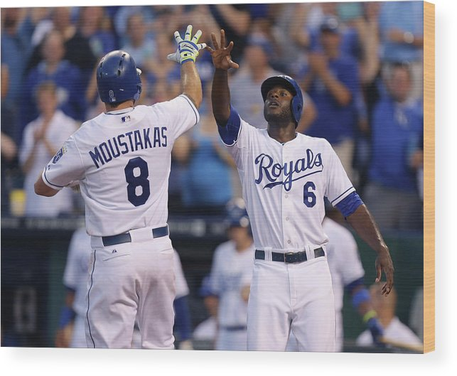 American League Baseball Wood Print featuring the photograph Mike Moustakas and Lorenzo Cain by Ed Zurga