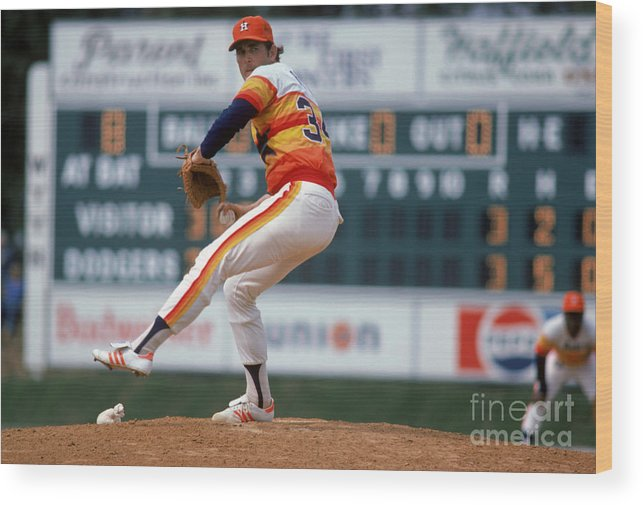 1980-1989 Wood Print featuring the photograph Nolan Ryan by Rich Pilling