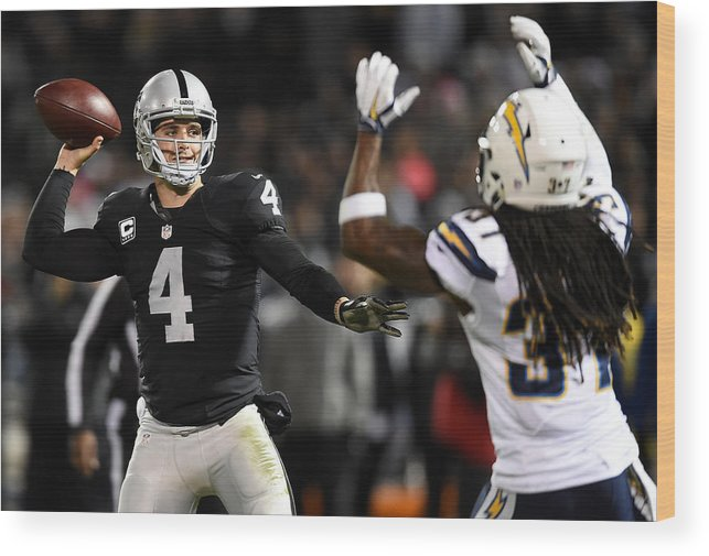 Three Quarter Length Wood Print featuring the photograph San Diego Chargers v Oakland Raiders by Thearon W. Henderson