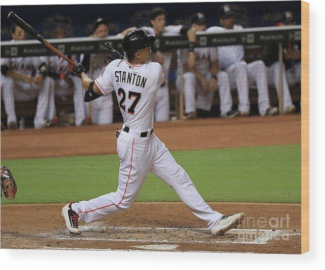 American League Baseball Wood Print featuring the photograph Giancarlo Stanton by Mike Ehrmann