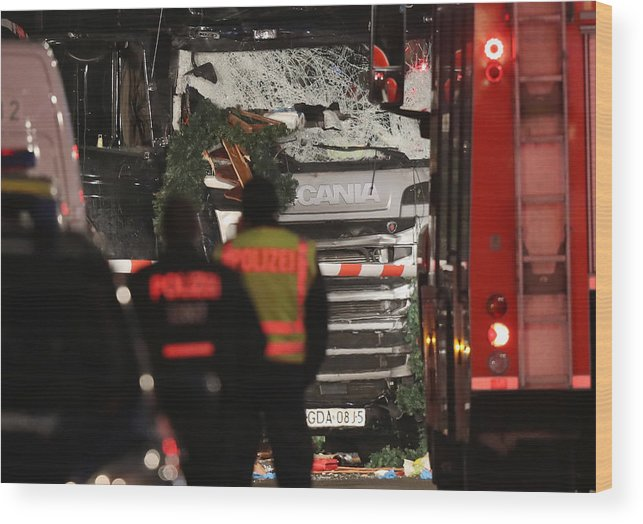 Berlin Wood Print featuring the photograph Lorry Drives Through Christmas Market In Berlin by Sean Gallup