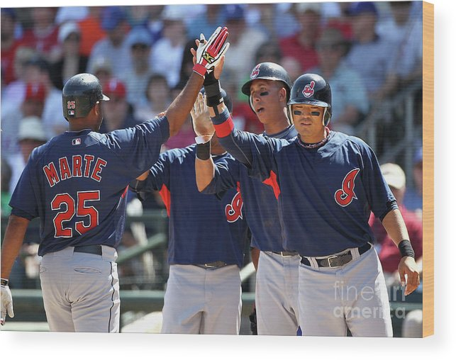 Anderson Hernández Wood Print featuring the photograph Andy Marte, Michael Brantley, and Shin-soo Choo by Christian Petersen