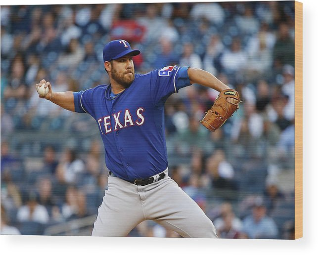 Three Quarter Length Wood Print featuring the photograph Colby Lewis by Al Bello