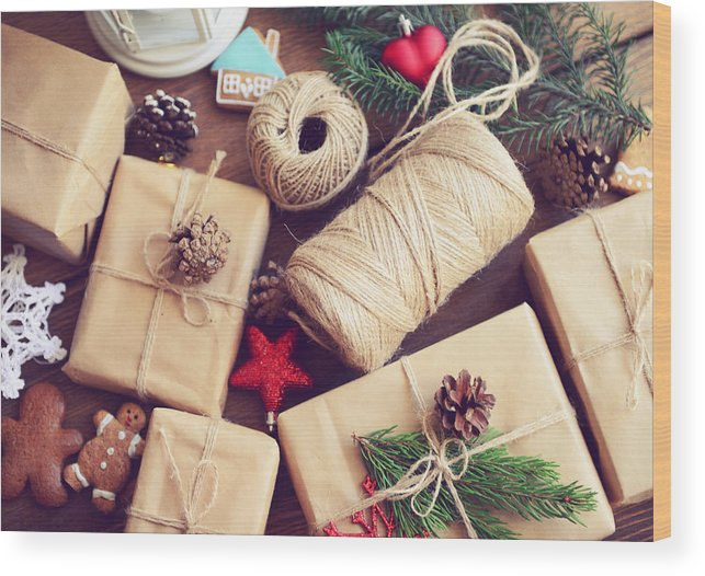Holiday Wood Print featuring the photograph Gift Box On A Wooden Background by Elenaleonova