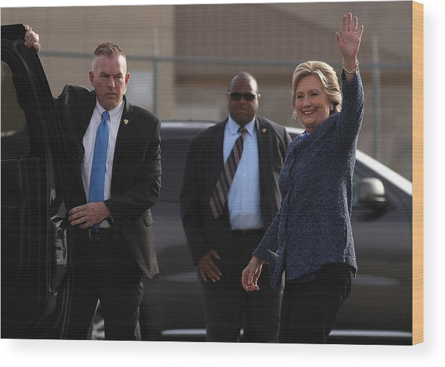 Nominee Wood Print featuring the photograph Hillary Clinton Holds Early Voting Rallies In Iowa by Justin Sullivan