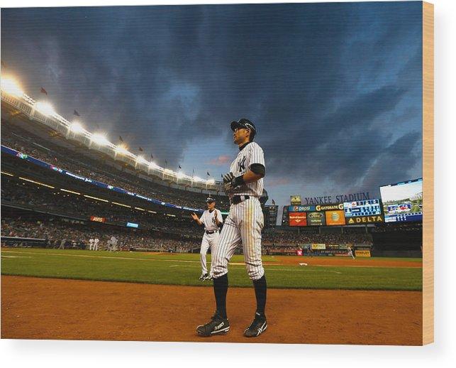 American League Baseball Wood Print featuring the photograph Ichiro Suzuki by Mike Stobe