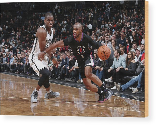 Nba Pro Basketball Wood Print featuring the photograph Isaiah Whitehead and Chris Paul by Nathaniel S. Butler