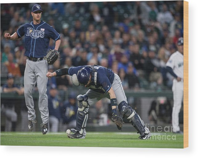 Baseball Catcher Wood Print featuring the photograph Jarrod Dyson, Derek Norris, and Alex Cobb by Stephen Brashear