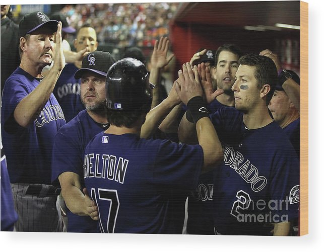 Scoring Wood Print featuring the photograph Jason Giambi, Todd Helton, and Troy Tulowitzki by Christian Petersen