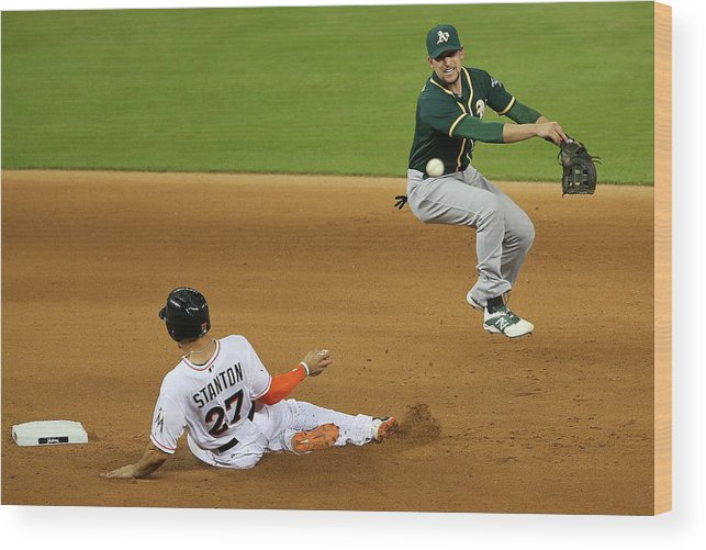 Double Play Wood Print featuring the photograph Jed Lowrie and Giancarlo Stanton by Mike Ehrmann