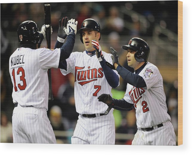 Game Two Wood Print featuring the photograph Joe Mauer, Jason Kubel, and Brian Dozier by Hannah Foslien