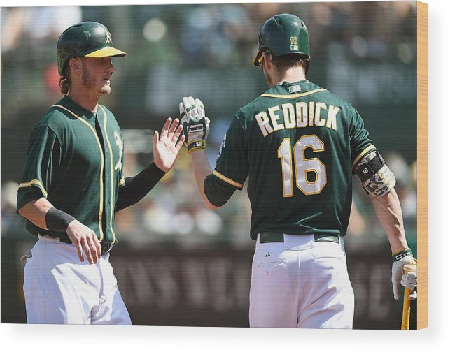 Ninth Inning Wood Print featuring the photograph Josh Reddick and Josh Donaldson by Thearon W. Henderson