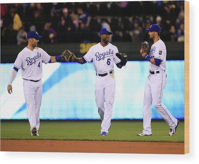 People Wood Print featuring the photograph Lorenzo Cain, Alex Gordon, and Paulo Orlando by Jamie Squire