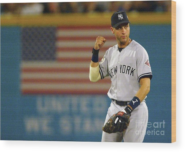 Fist Wood Print featuring the photograph Luis Castillo and Derek Jeter by Jed Jacobsohn