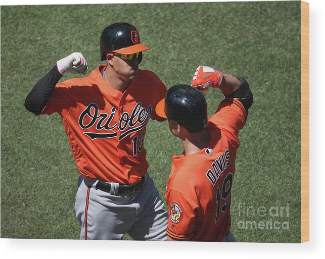 People Wood Print featuring the photograph Manny Machado and Chris Davis by Tom Szczerbowski