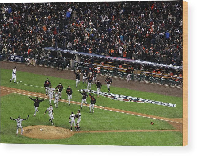 American League Baseball Wood Print featuring the photograph Miguel Cabrera and Sergio Romo by Christian Petersen