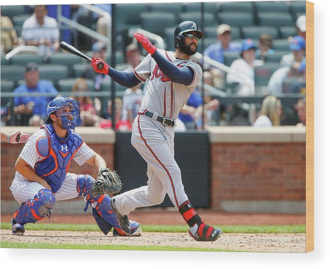 Following Wood Print featuring the photograph Nick Markakis by Jim Mcisaac