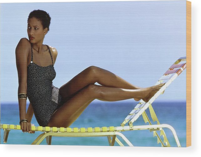 Fashion Wood Print featuring the photograph Peggy Dillard in a Polkadot Swimsuit by Guy le Baube