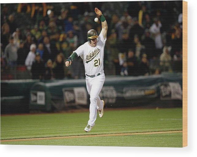 Ninth Inning Wood Print featuring the photograph Stephen Vogt by Ezra Shaw