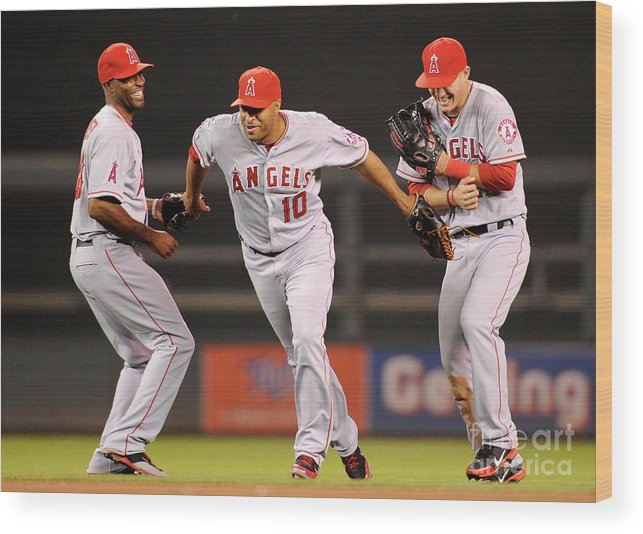 American League Baseball Wood Print featuring the photograph Torii Hunter, Vernon Wells, and Mike Trout by Hannah Foslien