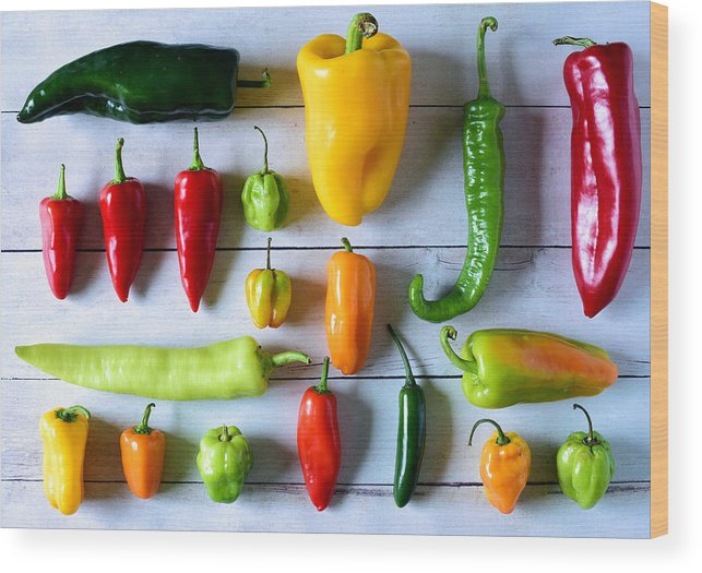 Orange Color Wood Print featuring the photograph Variety of fresh peppers by Photo by Cathy Scola