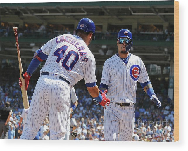 Following Wood Print featuring the photograph Willson Contreras and Javier Baez by Nuccio Dinuzzo