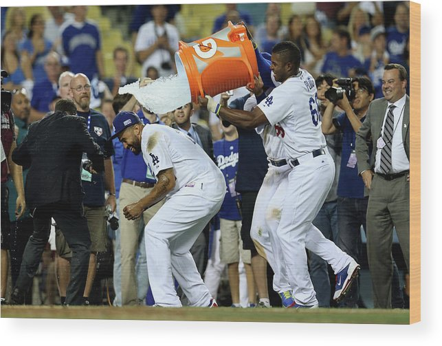 Game Two Wood Print featuring the photograph Yasiel Puig and Matt Kemp by Stephen Dunn