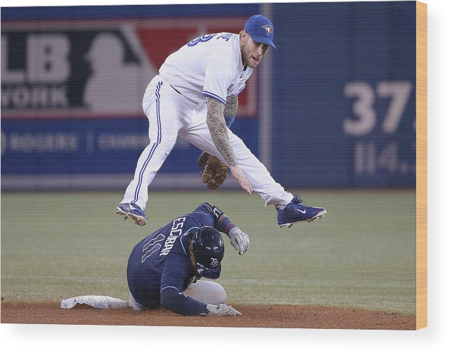 Double Play Wood Print featuring the photograph Yunel Escobar and Brett Lawrie by Tom Szczerbowski