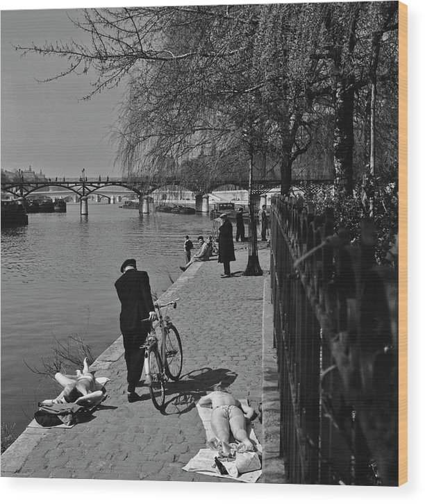 Sunbathing Wood Print featuring the photograph Relaxing By The Seine by Slim Aarons